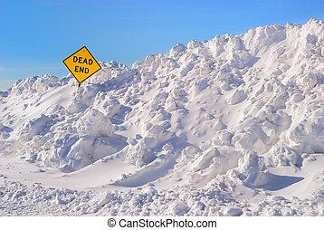 Dead End - Large plowed snowbank surrounding a dead end sign