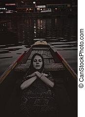 Dead girl in the boat
