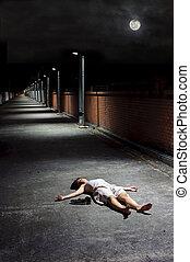 Dead girl - Female lies dead in the street under a night sky