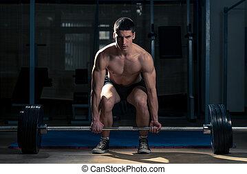 Dead lift - Muscular Man Lifting Deadlift In The Gym