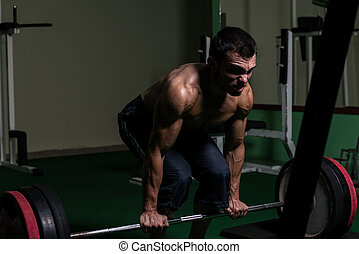 Dead Lift - Muscular Man Lifting Dead Lift In The Gym