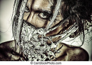Close-up portrait of a mythical creature male. Alien creature. Horror. Halloween.
