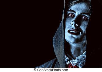 dead man - Gloomy, scary vampire in a black cloak hiding his...