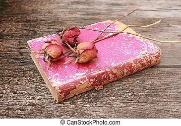 dead rose on old book