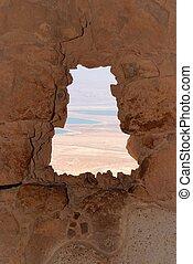 Dead Sea landscape seen through window of ruined Masada fortress, Israel