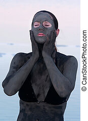 Dead Sea Minerals - Israel - A young woman in a bathing suit...