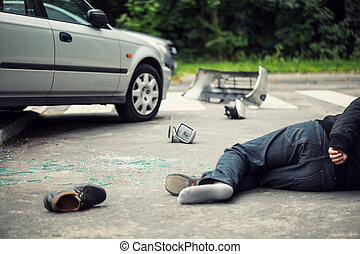 Dead victim after traffic incident with a broken car on the road