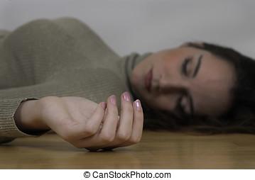 Dead woman curled hand lying on floor