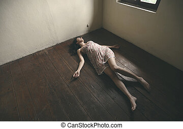 dead woman - Dead woman lying on the wooden floor. Empty...