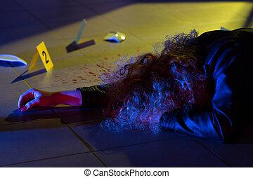 Dead woman lying on the floor