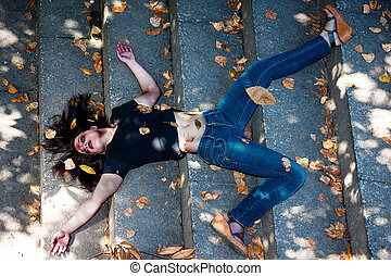 dead young woman on the stairs, with bruises