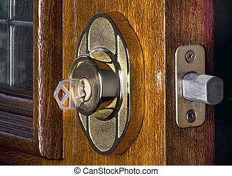 Deadbolt Lock - Deadbolt lock on mahogany front door.