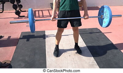 Deadlift - Weightlifting fitness man bodybuilding or powerlifting at outdoor gym