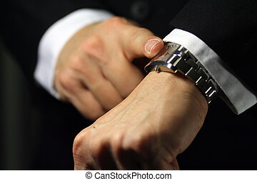 Deadline - A businessman looking at his watch, deadline/due...