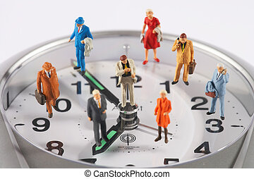 deadline constrains - plastic figures on a watch