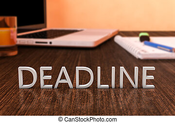 Deadline - letters on wooden desk with laptop computer and a...