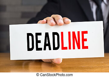 Deadline, message on white card and hold by businessman