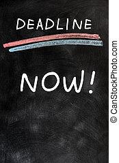 Deadline Now written on a blackboard - Deadline Now written...