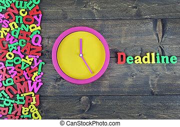 Deadline on wooden table