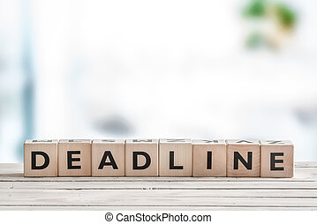 Deadline sign on a wooden table in an office