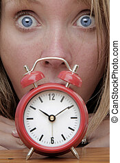 Deadline - Woman with red alarm clock representing lateness...