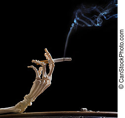 Deadly hand - Hand of death holding a smoking cigarette