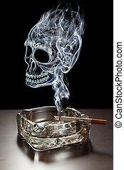 Deadly smoking - Smoke shaped like skull rising from burning...