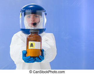 close-up of female scientist wearing white protection suit and mask holding a bottle labeled with deadly sign, on blue background