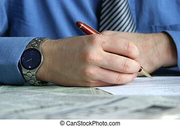 Hand with pen is signing a contract