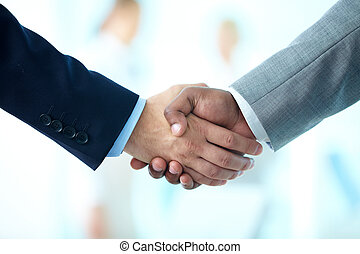 Deal is done - Close-up of business people shaking hands to...