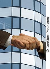 two businessmen handshaking ,made from my images