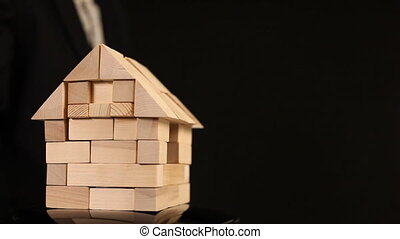 Toy wooden house. Passing the keys and handshake