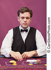 Dealer at table of a casino