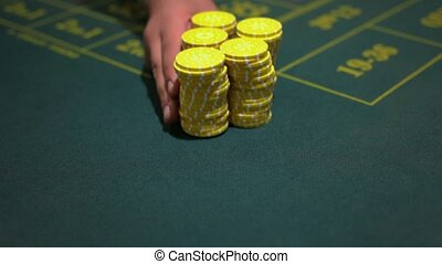 dealer cazino player with chips at casino table - casino,...