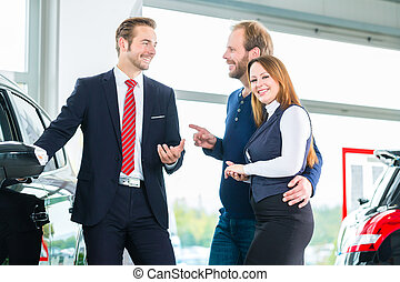 Dealer, clients and auto in car dealership