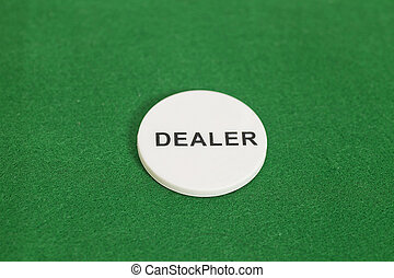 Dealer poker chip  on a game table in a casino