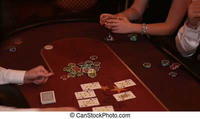 dealer pushes the chips to the man won in casino