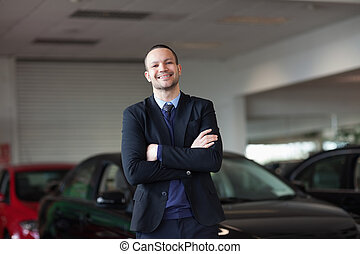 Dealer standing in front of a car