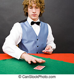 Dealing cards - A dealer at a poker game distributing cards