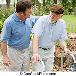 Dealing With Dementia - Adult son out for a walk with his...