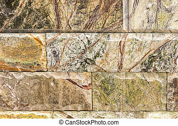 Dear marble brick with a green-brown pattern. background