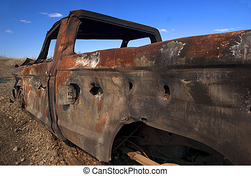 Deat Truck - Dead truck with lots of rust and bullet holes.