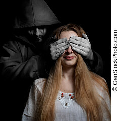 Death concept: woman surprised by evil sinister man