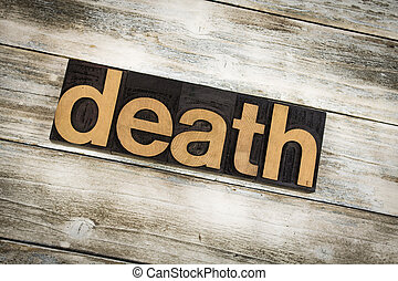 Death Letterpress Word on Wooden Background