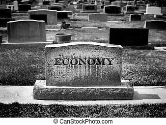 Graveyard and headstone or grave stone with economy carved as the name