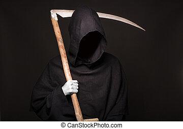 Death reaper over black background. Halloween. Studio...