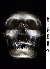 Death, represented by a blur of a human skull