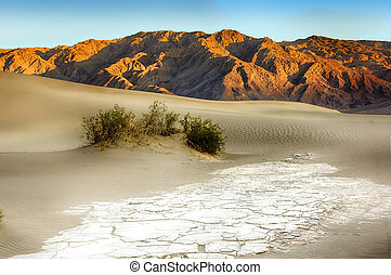 Sand Dunes And Mountains At Death Valley National Park, California, USA