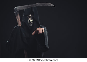 death with scythe standing at night