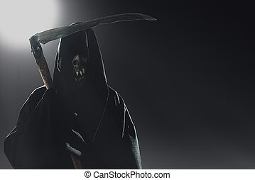death with scythe standing in the dark